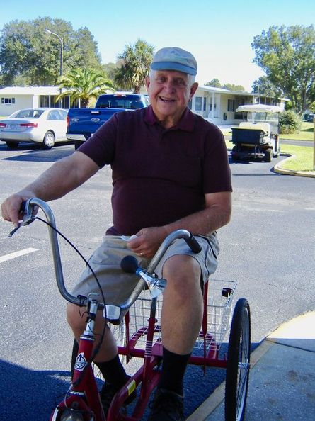 A resident of Forest Glenn enjoys riding his bike through the community.